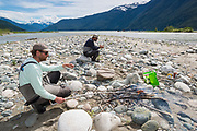 With the Dean River estuary as a backdrop, David Page and Pat Bogdan take time for shore lunch before resuming their hunt for June chinook.