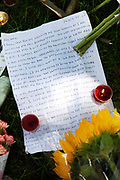 People gather and lay messages and flowers at a memorial opposite the home of Amy Winehouse, Camden Square, North London. It was announced that the tragic singer had died on 23rd July 2011. The music world has been paying tribute to singer Amy Winehouse, 27, who was found dead at her London home following years of drug and alcohol abuse largely attributed to her troubled character and fame.