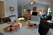 The kitchen and dining area are at the opposite end of a large open space a few steps from the living room. Sheridan and Rikki Glen are At Home in their Tanglewood subdivision home in Caseyville, IL on Wednesday January 16, 2019. <br /> Photo by Tim Vizer