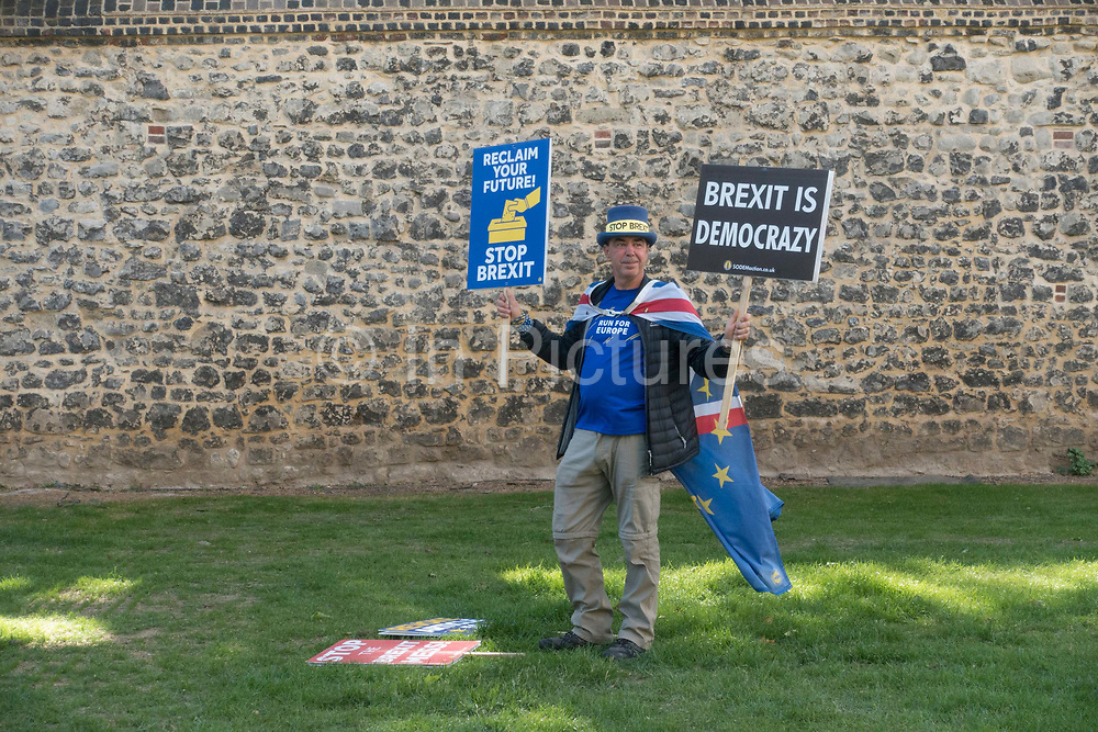 A pro remain campaigner holding anti Brexit placards at Abingdon Street Gardens on the 16th May 2019 in London in the United Kingdom.