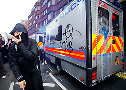 © under license to London News Pictures.  26/03/11 Anarchists attack a police van at the massive Anti-cuts march in London. Photo credit should read: Olivia Harris/ London News Pictures