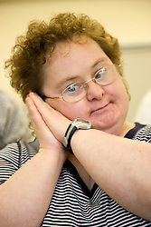 A woman Day Service users with learning disability using makaton a way of communicating with signs and symbols specially for people with learning difficulties,