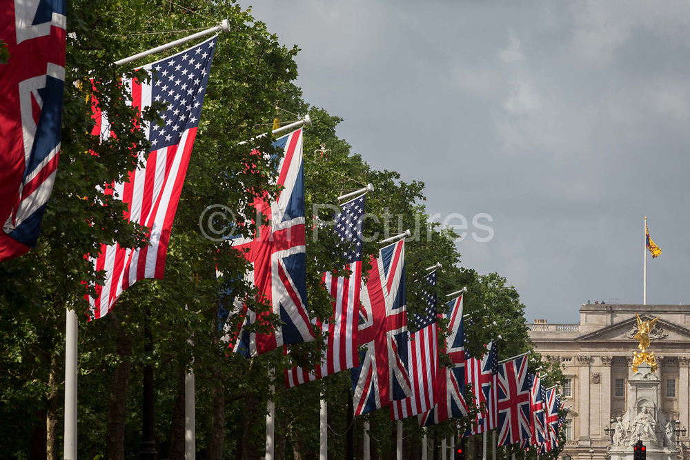 On US President Donald Trumps first day of a controversial three-day state visit to the UK by the 45th American President, The US Stars and Stripes hangs next to British Union Jack flags down the Mall and opposite Buckingham Palace, on 3rd June 2019, in London England.