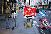 The road ahead is closed signs on Piccadilly as Londoners await the announcement of a second coronavirus lockdown it's business as usual in the West End with shoppers out and about and the pavements busy with people on what will be the last weekend before a month-long total lockdown in the UK on 31st October 2020 in London, United Kingdom. The three tier system in the UK has not worked sufficiently, to suppress the virus, and there have have been calls by politicians for a 'circuit breaker' complete lockdown to be announced to help the growing spread of the Covid-19.