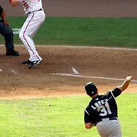 21 July 2007:  Colorado Rockies pitcher Rodrigo Lopez (31) pitches to Washington Nationals right fielder Austin Kearns (25) in the 5th inning.  The Nationals defeated the Rockies 3-0 at RFK Stadium in Washington, D.C.  ****For Editorial Use Only****