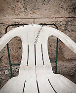 Stitches repair a plastic chair in Havana, Cuba