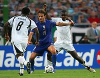 Hanover 12/6/2006 World Cup 2006<br /> <br /> Italia Ghana 2-0<br /> <br /> Photo Andrea Staccioli Graffitipress<br /> <br /> Alberto Gilardino Italy Samuel Kuffour (R) Michael Essien (L) Ghana