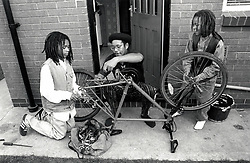 Father mending son's bicycle, UK 1990s
