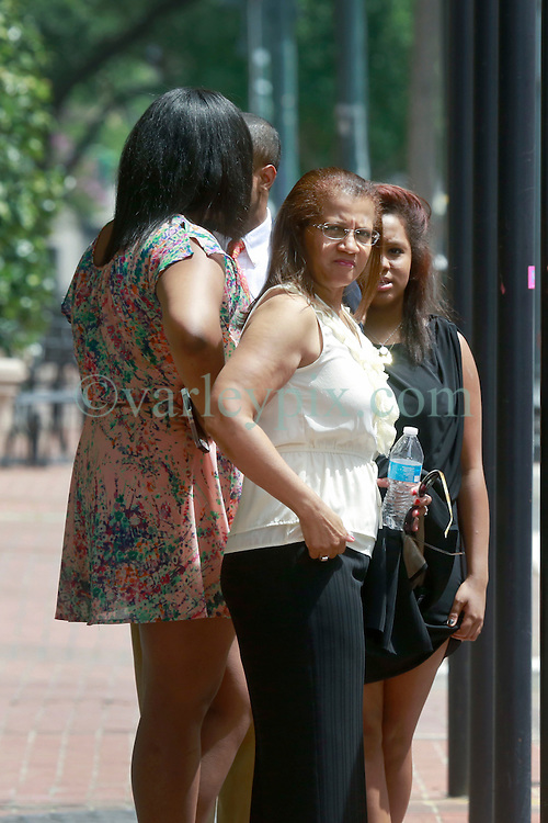 09 July 2014. New Orleans, Louisiana. <br /> Former mayor of New Orleans Ray Nagin's family including wife Seletha Smith, daughter Tianna and sons Jeremy and Jarin gather outside Nagin's attorney's office following Ray Nagin's sentencing hearing. Ray Nagin was sentenced to serve 10 years in prison for bribery and money laundering. <br /> Photo; Charlie Varley/varleypix.com