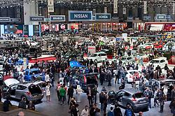 Interior view of crowds of visitors at the Geneva Motor Show 2011 Switzerland