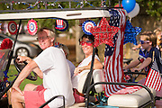 Golf carts decorated with bunting and American flags during the Sullivan's Island Independence Day parade July 4, 2015 in Sullivan's Island, South Carolina.