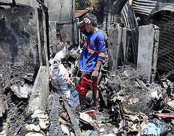 June 22, 2017 - A resident looks for reusable materials from their burnt home after a fire at a residential area in Manila, the Philippines. More than 100 shanties were razed in the fire, leaving 200 families homeless. (Credit Image: © Rouelle Umali/Xinhua via ZUMA Wire)