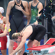 TOKYO, JAPAN - JULY 25: Bronte Campbell of Australia congratulates her sister Cate Campbell watched by team mates Meg Harris and Emma Mckeon after the Australian teams gold medal world record performance in the 4 x 100m Freestyle Relay for women during the Swimming Finals at the Tokyo Aquatic Centre at the Tokyo 2020 Summer Olympic Games on July 25, 2021 in Tokyo, Japan. (Photo by Tim Clayton/Corbis via Getty Images)