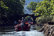 Tourist boats on the Gap trip negotiate the Old Weir Bridge while accessing the Upper Lake, Killarney.<br /> Photo Sally MacMonagle