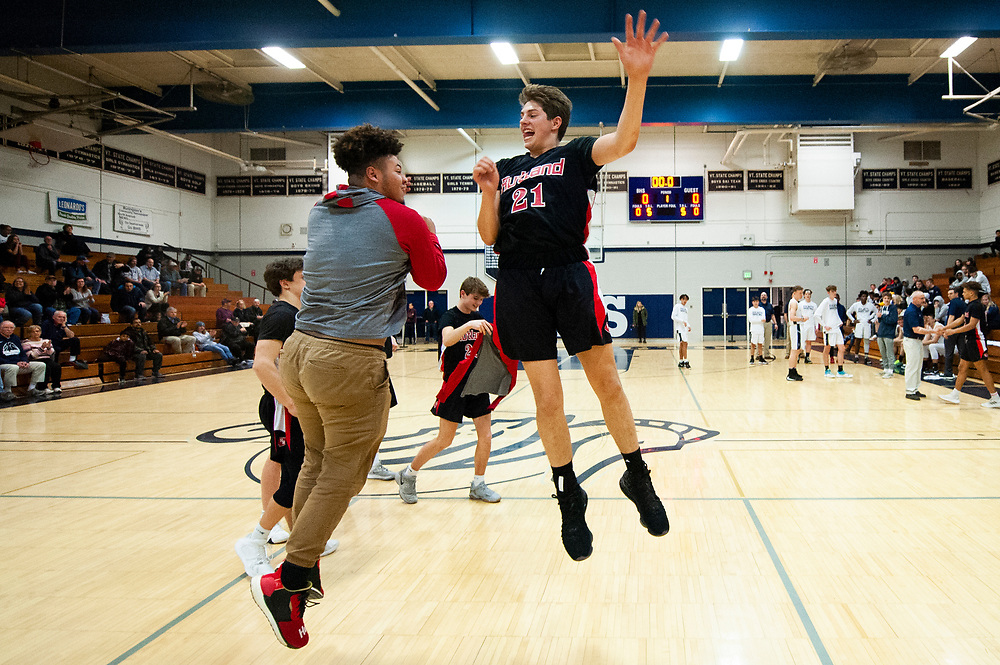 Rutland's Noah Depoy (21) takes the court for player introductions during the boys basketball game between the Rutland Raiders and the Burlington Seahorses at Burlington High School on Tuesday night February 25, 2020 in Burlington, Vermont. (BRIAN JENKINS/for the FREE PRESS)