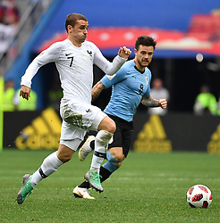 France's Antoine Griezmann and Uruguay's Nahitan Nandez during the FIFA World Cup 2018 Round of 8 France v Uruguay match at the Nizhny Novgorod Stadium Russia, on July 6, 2018. France won 2-0. Photo by Christian Liewig/ABACAPRESS.COM