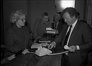Opening of Automatic Telephone Exchange, Aran Mor..1980-06-20.20th June 1980.20/06/1980.06-20-80..Photographed at Kilronan, Inismore:..Minister of State at the Department of Posts and Telegraphs, Mark Killilea, opens the new automatic exchange at Kilronan on Inismore. The Minister is making is making the first automatic call to the postmistress's relations in the United States. ..Máire Bn. Nic Giolla Phádraig, Postmistress Kilronan, looks on.