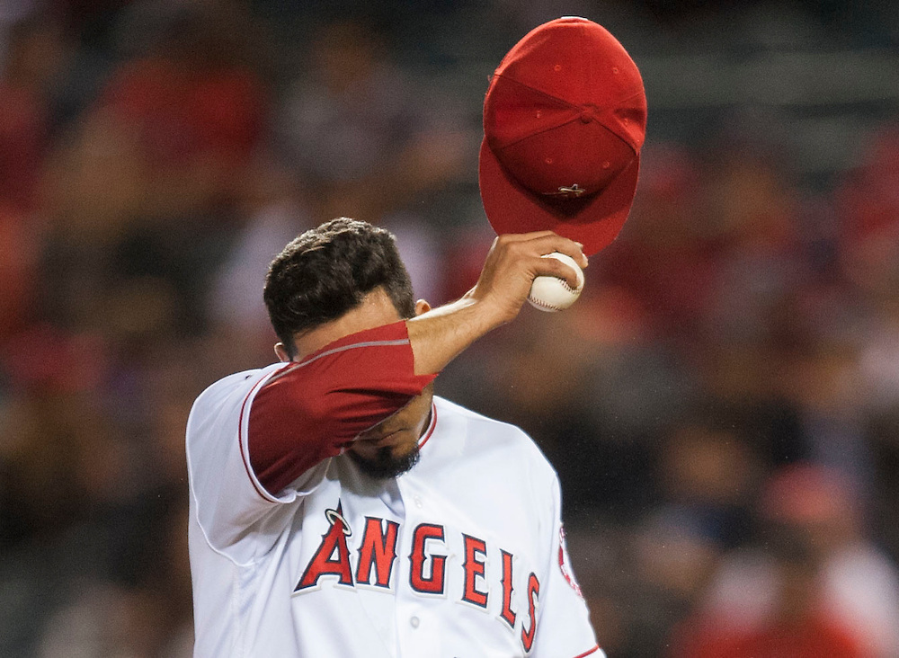 The Angels' Fernando Salas wipes his forehead after giving up the tying home run to the Detroit Tigers' Victor Martinez in the eighth inning Tuesday at Angel Stadium.<br /> <br /> ///ADDITIONAL INFO:   <br /> <br /> angels.0531.kjs  ---  Photo by KEVIN SULLIVAN / Orange County Register  -- 5/31/16<br /> <br /> The Los Angeles Angels take on the Detroit Tigers Tuesday at Angel Stadium.