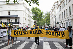Activists hold a Defend Black Youth banner during a Kill The Bill National Day of Action in protest against the Police, Crime, Sentencing and Courts (PCSC) Bill 2021 on 29th May 2021 in London, United Kingdom. The PCSC Bill would grant the police a range of new discretionary powers to shut down protests, including the ability to impose conditions on any protest deemed to be disruptive to the local community, wider stop and search powers and sentences of up to 10 years in prison for damaging memorials.