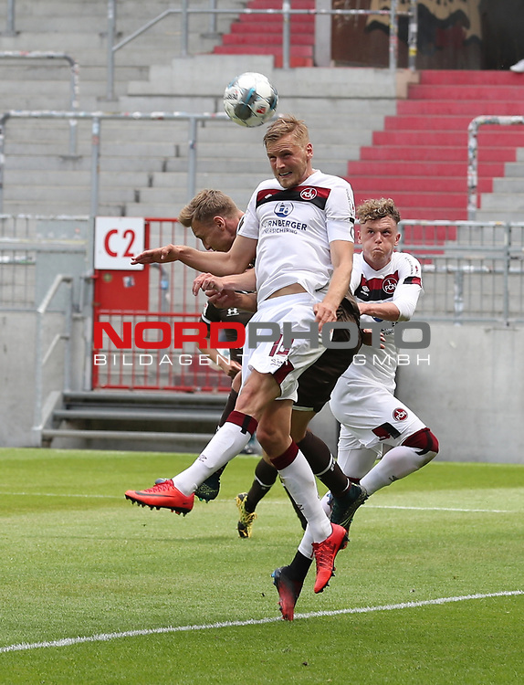 nph0001:  17.05.2020 --- Fussball --- Saison 2019 2020 --- 2. Fussball - Bundesliga --- 26. Spieltag: FC Sankt Pauli - 1. FC Nürnberg ---   DFL regulations prohibit any use of photographs as image sequences and/or quasi-video - Only for editorial use ! --- <br /> <br /> Hanno Behrens (18, 1. FC Nürnberg ) Sebastian Ohlsson (43, FC St. Pauli ) Robin Hack (17, 1. FC Nürnberg ) <br /> <br /> Foto: Daniel Marr/Zink/Pool//via Kokenge/nordphoto