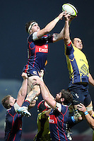 Daniel Carp (R) of Romania tries to stop John Cullen (L) of USA during their  rugby test match, on National Stadium Arc de Triomphe in Bucharest, November 8, 2014.