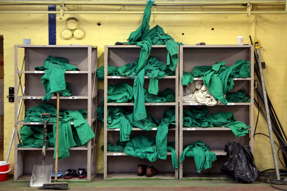 Overalls thrown on the shelf at the end of a shift in the engineering workshop at Coldingley prison..HMP Coldingley, Surrey was built in 1969 and is a Category C training prison. Coldingley is focused on the resettlement of prisoners and all prisoners must work a full working week within the prison. Its capacity is 390 prisoners.