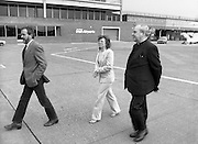 Trocaire Team Departs for Ethiopia..1985..24.03.1985..03.24.1985..24th March 1985..To view the Trocaire relief project on the ground,.Cardinal Tomas O Fiaich,Chairman of Trocaire,accompanied by Mr Brian Mc Keown,Director of Trocaire and Ms Sally O'Neill,Head of Trocaire Projects departed Dublin Airport on their way to Ethiopia and Sudan. Trocaire along with many other agencies were assisting in famine relief on the African Continent...Image shows Cardinal O'Fiaich,Ms O'Neill and Mr McKeown crossing the tarmac to the waiting aircraft.