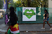 Graffiti critical of the Prime Minister is seen on a banner at Notting Hill carnival on 25th August, 2019 in London, United Kingdom. One million people are expected on the streets in scorching temperatures for the Notting Hill Carnival, Europes largest street party and a celebration of Caribbean traditions.