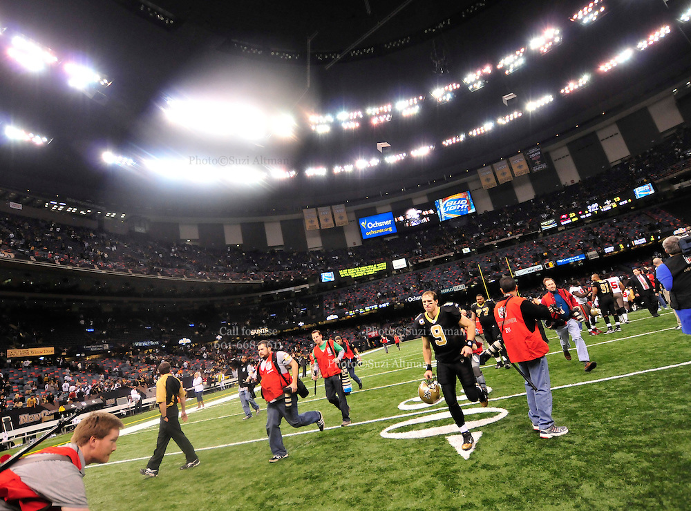 New Orleans QB Drew Brees runs off the field helmut in hand at the end of the Tampa Bay game. The Saints loss 23-13.the endzone and prays before the game against the Tampa Bay Buccaneers Sunday Jan. 2,2011. The Bucs went on to win 23-13. The New Orleans Saints play the Tampa Bay Buccaneers in the last Sunday game of the regular  season before the playoffs in New Orleans at the Super Dome in Louisiana Sunday Jan 2, 2011.Photo©SuziAltman