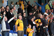 Newport County fans in fine voice on the road at Bury. Skybet Football League two match, Bury v Newport county at Gigg Lane in Bury on Saturday 5th Oct 2013. pic by David Richards, Andrew Orchard sports photography,