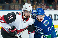 KELOWNA, BC - SEPTEMBER 29:  Brendan Perlini #11 of the Arizona Coyotes faces off against Loui Eriksson #21 of the Vancouver Canucks at Prospera Place on September 29, 2018 in Kelowna, Canada. (Photo by Marissa Baecker/NHLI via Getty Images)  *** Local Caption *** Loui Eriksson;Brendan Perlini
