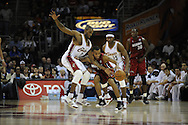 Joe Smith, left, and Devin Brown of Cleveland guard Daequan Cook of Miami..The Miami Heat lost to the host Cleveland Cavaliers 84-76 at Quicken Loans Arena, April 13, 2008...