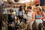 Customers look at handcrafts at the 22nd Salon International de l'Artisanat de Ouagadougou (SIAO) in Ouagadougou, Burkina Faso on Saturday November 1, 2008.