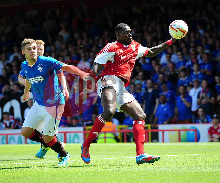 Bristol City's Jay Emmanuel-Thomas battles for the ball with Glasgow Rangers' Kyle Hutton - Photo mandatory by-line: Joe Meredith/JMP - Tel: Mobile: 07966 386802 13/07/2013 - SPORT - FOOTBALL - Bristol -  Bristol City v Glasgow Rangers - Pre Season Friendly - Bristol - Ashton Gate Stadium