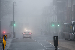 © London News Pictures. 21/02/2017. Aberystwyth, UK.<br /> Thick fog and mist engulfs traffic in Aberystwyth in the early morning on damp and mild February day. Photo credit: Keith Morris/LNP