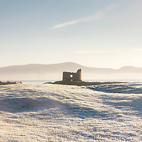 McCarthy Castle on Ballinskelligs Beach on a frosty winter morning, County Kerry, Ireland along the Wild Atlantic Way | Skellig Coast<br /> <br /> bs001