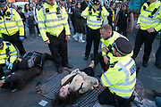 April, 18th, 2019 - London, Greater London, United Kingdom: Westminster Parliament Square Demonstration against Climate Crisis. Extinction Rebellion is demanding the UK government takes urgent action on climate change and wildlife declines. Extinction Rebellion activists disrupt traffic around famous London Landmarks. Thousands of protesters  converging on central hubs including Oxford Circus and Parliament Square. Nigel Dickinson/Polaris