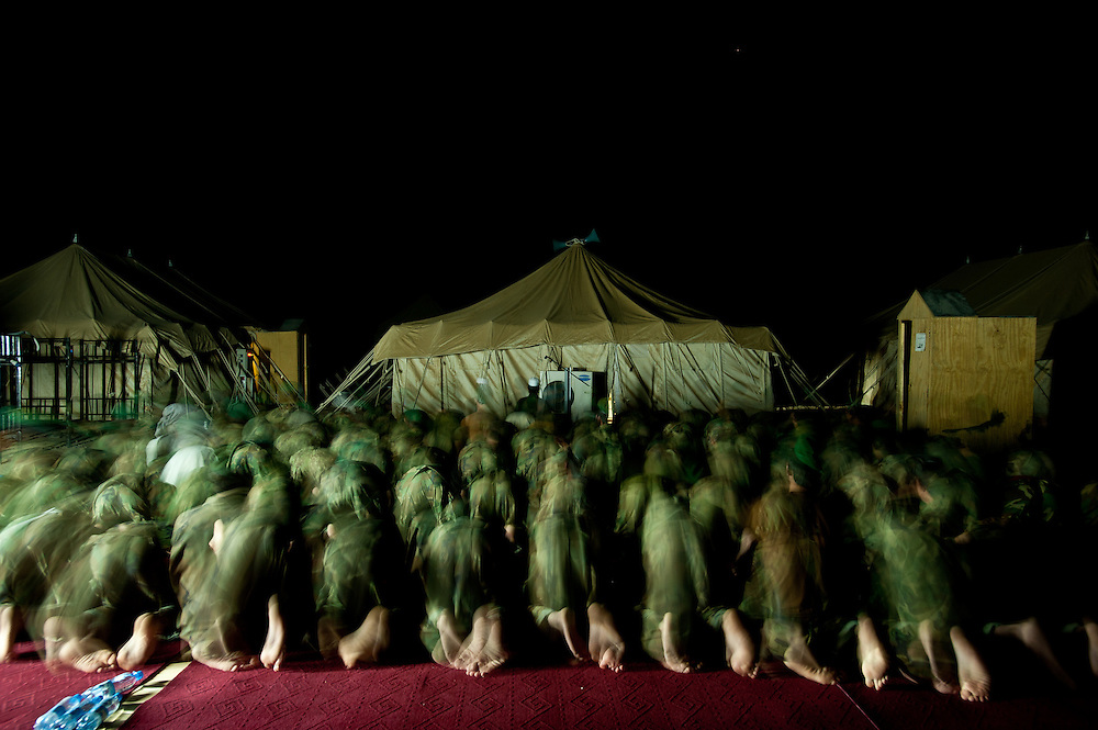 Afghan National Army soldiers pray together during Ramadan.