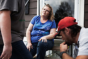 CULLMAN, AL – OCTOBER 13, 2014: <br /> Donald Abbott, 35, (left) walks through the yard with son Brody, 9, and wife Jamie, 33. In February 2014, the Abbott family purchased a sofa set from Buddy's Home Furnishings, opting to pay for it in weekly installments at a high interest rate. If the family continues to pay throughout the entire two-year payment plan, the sofa set will cost them over $4,000. The father, Donald Abbott, is the sole breadwinner of the family, making between $230 and $500 a week. On bad weeks, the $110 sofa payment equals roughly half the family income. (Photo by Bob Miller/For The Washington Post)
