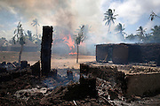 A Pokomo village burns in the Delta region of the Kenyan Coast after what residents say, was a retaliation raid by Kenyan security forces who accused residents of this particular village to have been involved in a deadly attack on a neighbouring Orma settlement that left dozens of residents and seven police officers guarding the village dead.