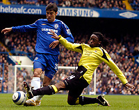 Photo: Alan Crowhurst.<br />Chelsea v Manchester City. The Barclays Premiership. 25/03/2006. Chelsea's Paulo Ferreira (L) gets tackled by Kizito Musampa.