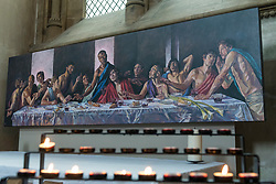 © Licensed to London News Pictures. 04/07/2020. ST ALBANS, UK. A version of the Last Supper, with Jesus as a black man, on display at St Albans Cathedral in support of Black Lives Matter.  The 8ft 8in-high (2.6m) high-resolution print of Lorna May Wadsworth's version of Leonardo da Vinci's 15th century masterpiece is on display above the Altar of the Persecuted in the North Transept of the cathedral and shows Tafari Hinds, a Jamaican model, as Jesus The artwork is part of a prayer installation to mark the cathedral's reopening after coronavirus pandemic lockdown restrictions were eased by the UK government.  Photo credit: Stephen Chung/LNP