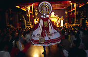 An actor leaps into the audience during a production of the Ramayana at the Kerala Kalamandalam.<br /> The Kalamandalam was founded in 1930 to preserve the cultural traditions of Kathakali, the stylised dance drama of Kerala. Kathakali is the classical dance-drama of Kerala, South India, which dates from the 17th century and is rooted in Hindu mythology. Kathakali is a unique combination of literature, music, painting, acting and dance performed by actors wearing extensive make up and elaborate costume who perform plays which retell in dance form stories from the Hindu epics.