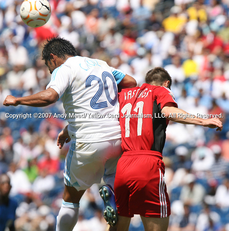 16 June 2007: Guatemala's Carlos Ruiz (20) earns a yellow card for hitting Canada's Richard Hastings (11) in the head with an elbow with this challenge in the second half. The Canada Men's National team defeated the Guatemala Men's National Team 3-0 at Gillette Stadium in Foxboro, Massachusetts in a 2007 CONCACAF Gold Cup quarterfinal.