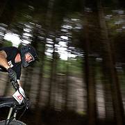 Mountain bike racers tackle the Ben Lomond Forest course high above Queenstown during practice for the Corona Dirtmasters Downhill event in Queenstown, Central Otago, which takes place on Sunday. The technically demanding course will start at the Gondola and finish in Brecon Street. The event was part of the inaugural Queenstown Bike Festival, taking place from 16th-25th April. The event hopes to highlight Queenstown's growing profile as one of the three leading biking centres in the world. Queenstown, Central Otago, New Zealand. 22nd April 2011. Photo Tim Clayton..