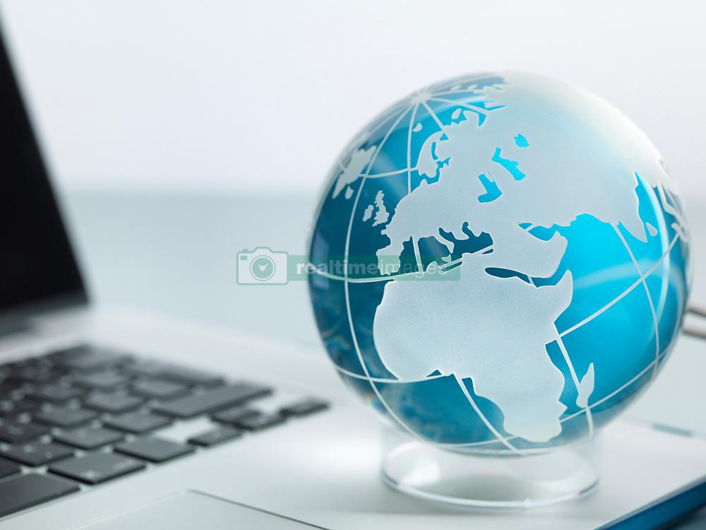 May 8, 2017 - Globe and laptop on desk (Credit Image: © Andrew Brookes/Image Source via ZUMA Press)