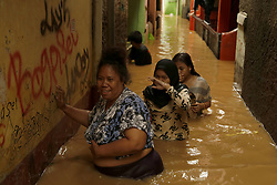 February 6, 2018 - Jakarta, Indonesia - Residents evacuate their goods during the massive flood that hit the low settlements in Jakarta, Tuesday, February 6, 2018. Information Data Center and Public Relations of the National Disaster Prevention Agency (BNPB) will reach the Manggarai Water Gate, Jakarta. The flood is predicted to flood the river banks such as Srengseng Sawah, Rawajati, Kalibata, Pengadegan, Pejaten Timur, Kebon Baru, Bukit Duri, Balekambang, Cililitan, Chinese Bidara and Kampung Melayu, caused by heavy rain and high river water flow from Bogor to Jakarta. Edi Ismail  (Credit Image: © Edi Ismail/NurPhoto via ZUMA Press)