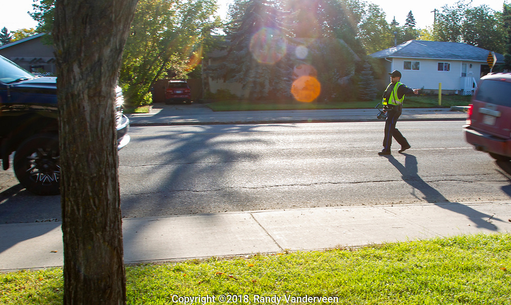Photo Randy Vanderveen<br /> Grande Prairie, Alberta<br /> 2018-09-04<br /> Officer Mark Topolinski of Commercial Vehicle Enforcement checks the speed of vehicles driving through the Swanavon School zone on the first morning of classes Tuesday, Sept. 4. Topolinski was just stopping offenders and warning them to slow down and remember that school is back in session. Meanwhile other school zone enforcement in the South Peace by other enforcement agencies and the RCMP netted some drivers a more costly reminder that school zones are back in effect.