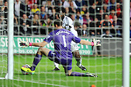 Arsenal keeper Wojciech Szczesny saves a shot from Swansea's Wilfried Bony.  Barclays Premier league, Swansea city v Arsenal at the Liberty Stadium in Swansea on Saturday 28th Sept 2013.  pic by Andrew Orchard, Andrew Orchard sports photography.