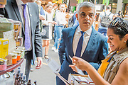 The Mayor Sadiq Khan meets stall holders and buys a box of spices from the Spice Mountain - The market reopening is signified by the ringing of the bell and is attended by Mayor Sadiq Khan. Tourists and locals soon flood back to bring the area back to life. London 14 Jun 2017
